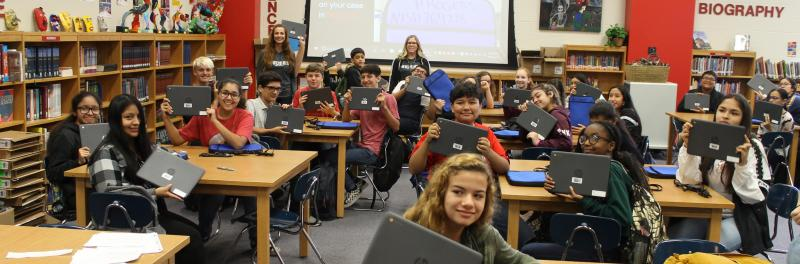 Students receiving their Chromebooks during distribution