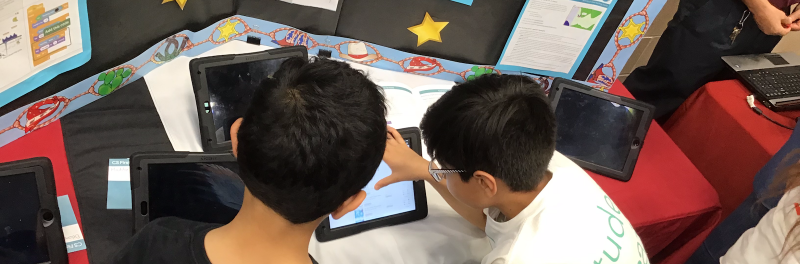 Students working on an iPad at 2018 Expo.
