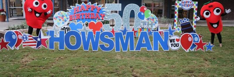 image of front of the school with 50th birthday sign