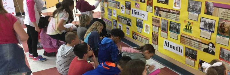 Students using hallway learning for black history month