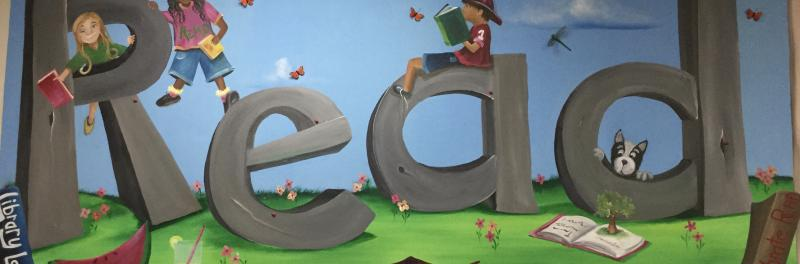 Painting of the word read with books and kids reading sitting on the letters