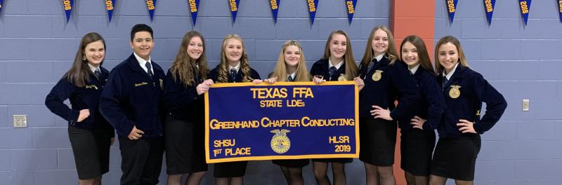 O'Connor GreenHand Chapter Conducting Team with State banner.
