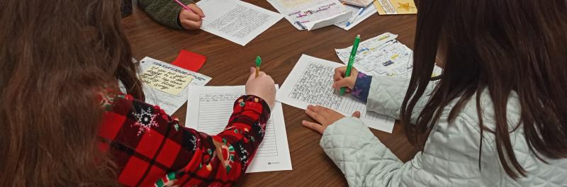 students working on writing project