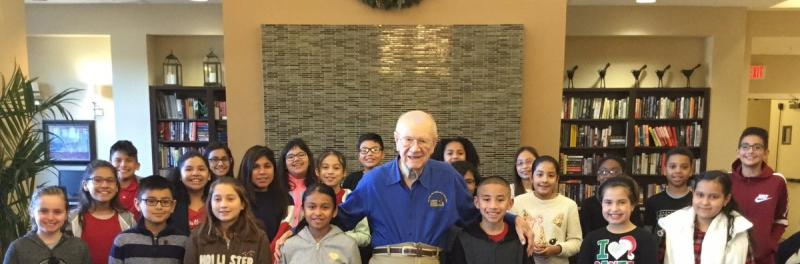 Namesake, Mr. Jimmy Elrod at library with Elrod students.