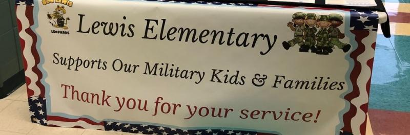 White and purple display table for support of Military Kids and Families