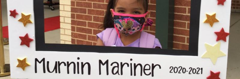 Mainer's first day of school with sign showing school spirit.