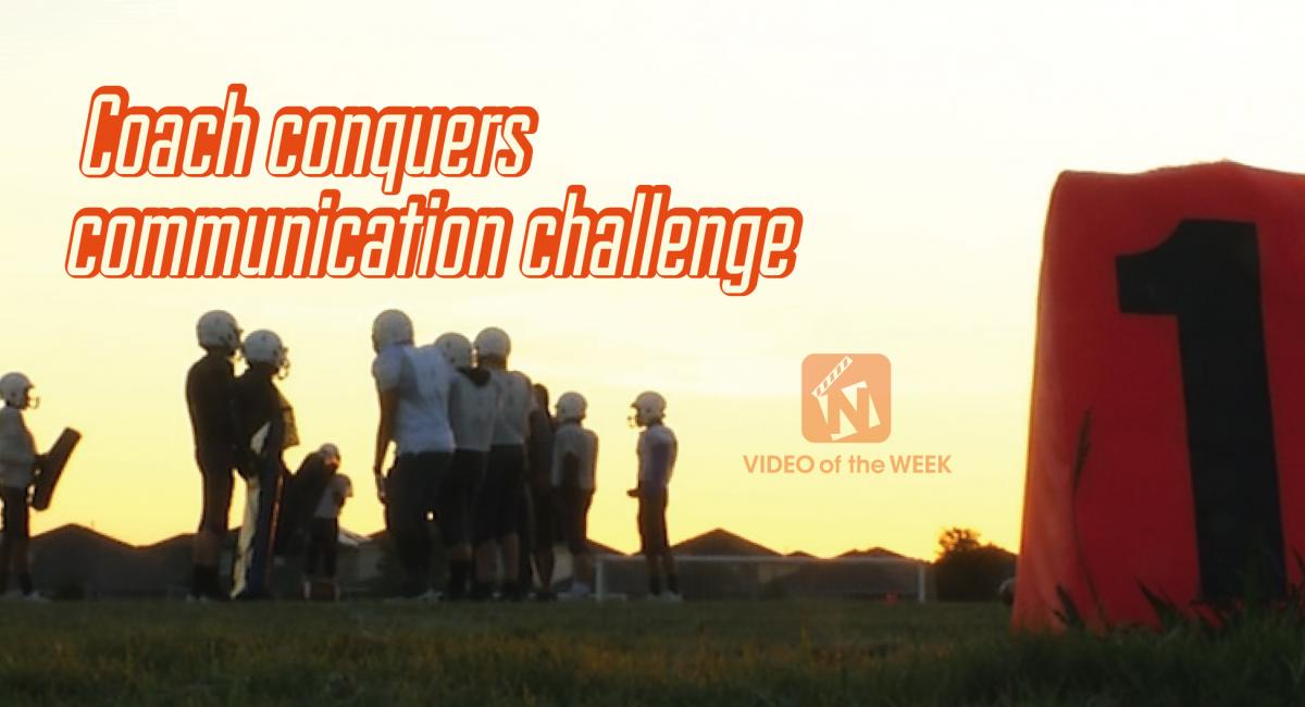 Coach conquers communication challenge with background of football players working together