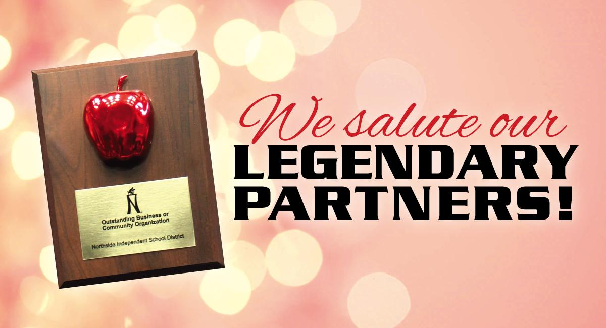 Award plaque with apple; words 'We salute our legendary partners'
