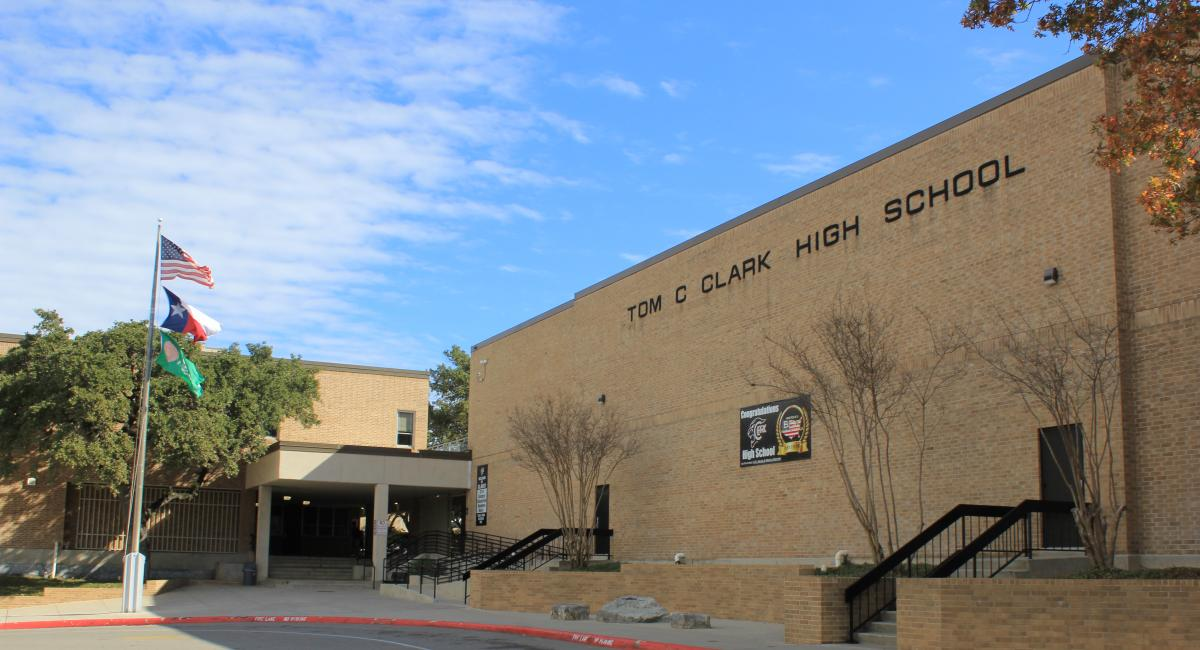 view of Clark High School entrance with flag pole in foreground