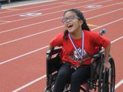 student in wheelchair racing