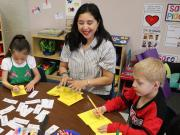 Teacher with her students coloring