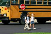 children walking from bus