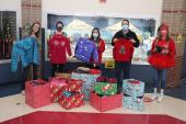 Steubing PTA and staff donate boxes of coats to Carnahan PTA and staff