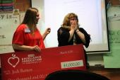 Teacher Jodi Ramos reacts to receiving HEB award and check for $1,000